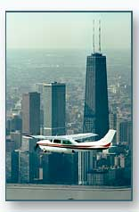 Cessna 210 Flying by the John Hancock Building in Chicago