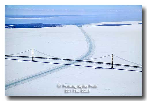 Aerial Photo Of The Mackinac Bridge In The Winter Showing